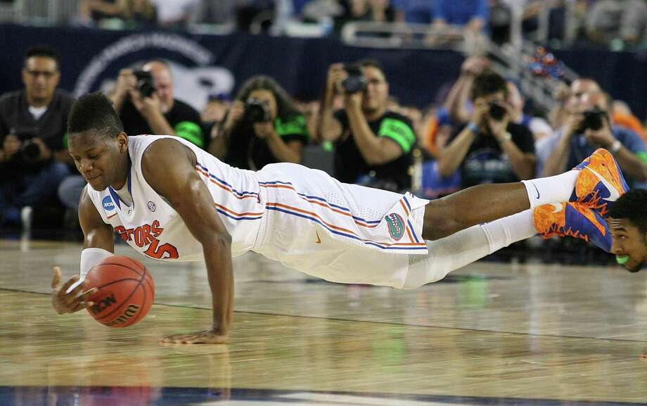 Florida 62, Florida Gulf Coast 50Florida's Will Yuguete dives for a loose ball in the first half against Florida Gulf Coast in the NCAA Tournament's Sweet 16 game at Cowboys Stadium in Arlington, Texas, on Friday, March 29, 2013. (Stephen M. Dowell/Orlando Sentinel/MCT) Photo: Stephen M. Dowell, McClatchy-Tribune News Service / Orlando Sentinel
