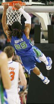 Florida Gulf Coast's Sherwood Brown (25) dunks in the first half against Florida in the NCAA Tournament's Sweet 16 game at Cowboys Stadium in Arlington, Texas, on Friday, March 29, 2013. (Stephen M. Dowell/Orlando Sentinel/MCT) Photo: Stephen M. Dowell, McClatchy-Tribune News Service / Orlando Sentinel