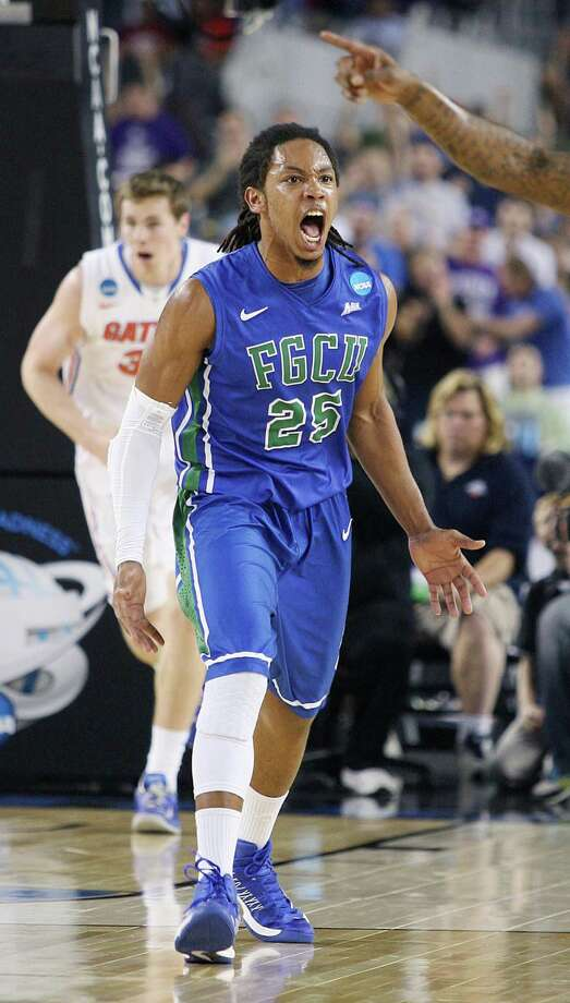 Florida Gulf Coast's Sherwood Brown (25) celebrates after a first-half dunk against Florida in the NCAA Tournament's Sweet 16 game at Cowboys Stadium in Arlington, Texas, on Friday, March 29, 2013. (Stephen M. Dowell/Orlando Sentinel/MCT) Photo: Stephen M. Dowell, McClatchy-Tribune News Service / Orlando Sentinel