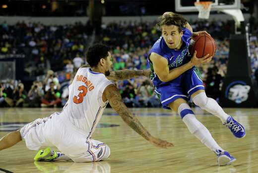 Florida Gulf Coast's Christophe Varidel drives around Florida's Mike Rosario (3) during the first half of a regional semifinal game in the NCAA college basketball tournament, Friday, March 29, 2013, in Arlington, Texas. (AP Photo/Tony Gutierrez) Photo: Tony Gutierrez, Associated Press / AP