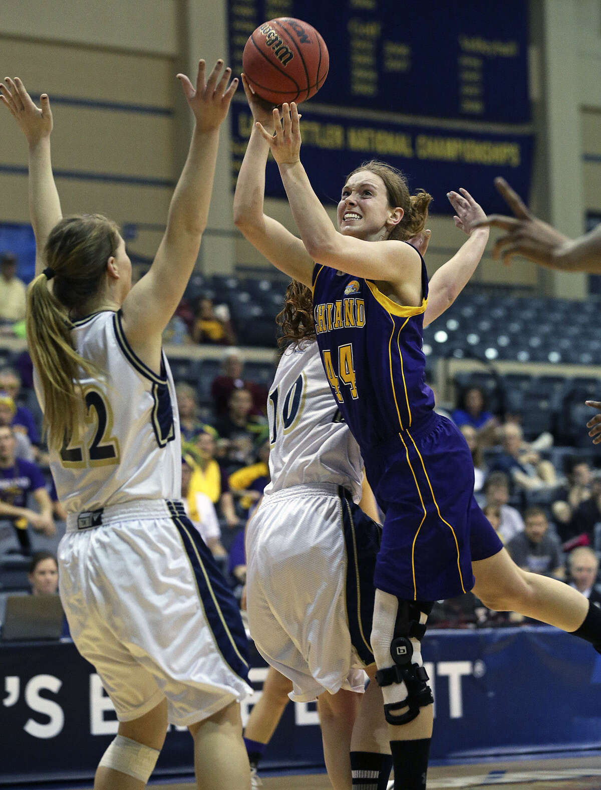 Kari Daugherty of Ashland tries to get off a shot in traffic Friday night at Greehey Arena. The Division II tournament MVP had 26 points and 12 boards in the victory.