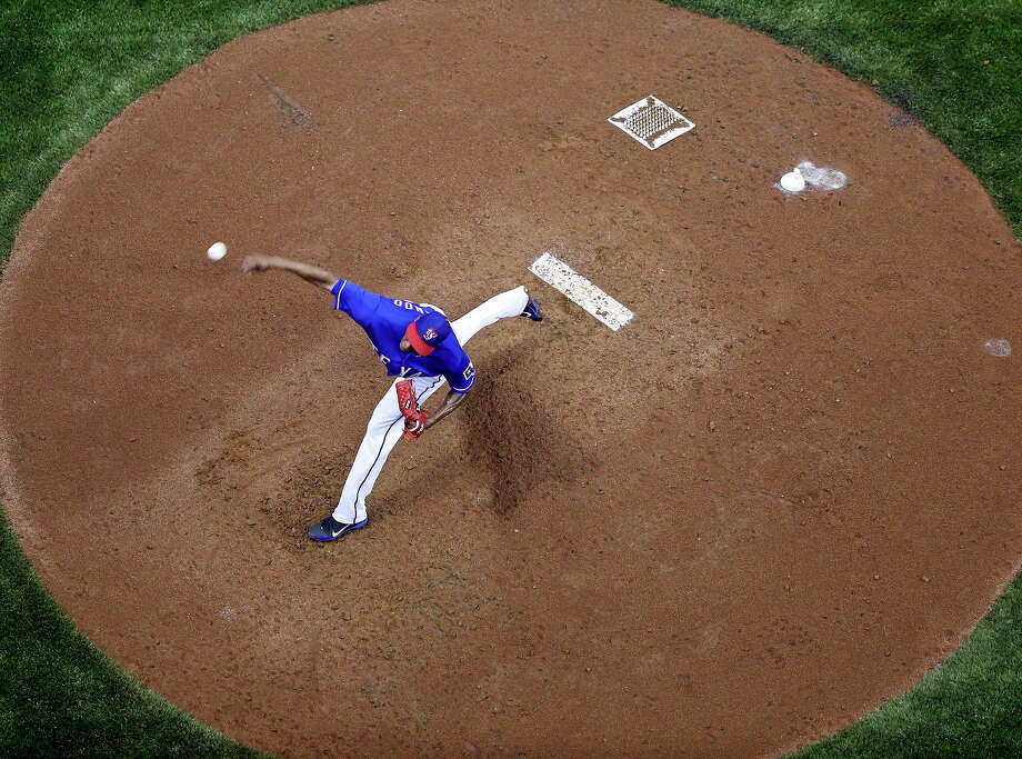 Texas Rangers' Alexi Ogando pitches against the San Diego Padres during an exhibition baseball game part of the �Big League Weekend� Friday March 29, 2013 at the Alamodome. Photo: Edward A. Ornelas, Express-News / © 2013 San Antonio Express-News