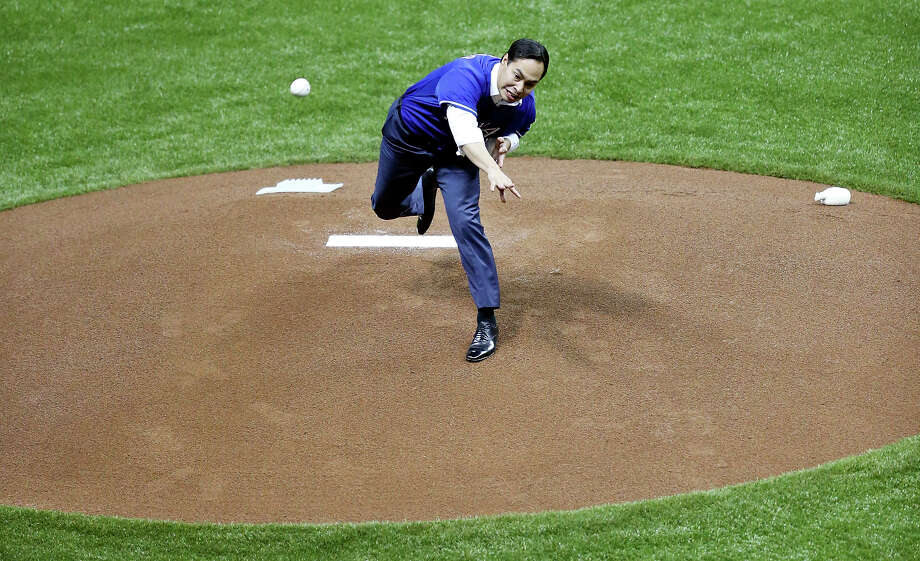Mayor Julian Castro throws out the first pitch before the Texas Rangers and San Diego Padres exhibition baseball game part of the �Big League Weekend� Friday March 29, 2013 at the Alamodome. Photo: Edward A. Ornelas, Express-News / © 2013 San Antonio Express-News