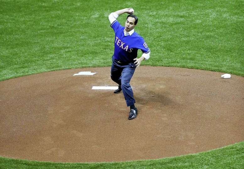 Mayor Julian Castro throws out the first pitch before the Texas Rangers and San Diego Padres exhibit