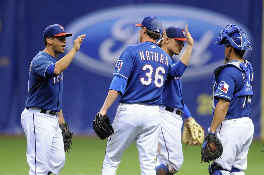 Texas Rangers relief pitcher Joe Nathan (36) greets teammates after defeating the San Diego Padres 5-4 during Big League Weekend at the Alamodome on Friday, March 29, 2013. The Rangers and Padres played the first-ever baseball game in the Alamodome. A second game will be played on Saturday afternoon. Photo: Billy Calzada, Express-News / San Antonio Express-News