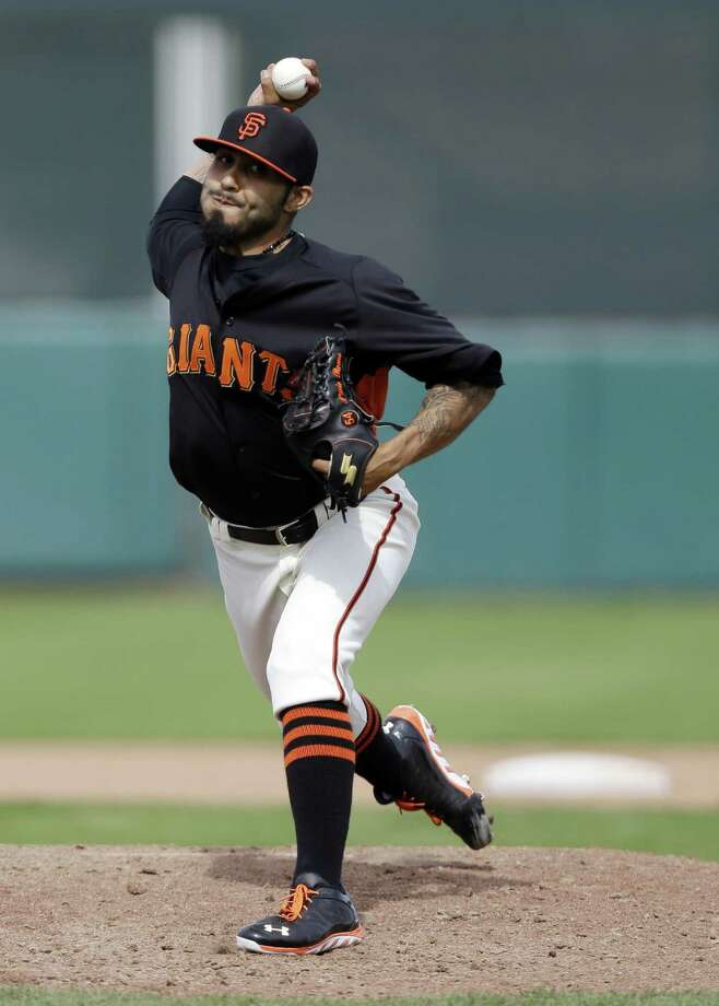 Sergio Romo, who had an eye-popping 0.84 ERA in 10 playoff games last year, will start the season as the Giants' closer. Photo: Marcio Jose Sanchez / Associated Press