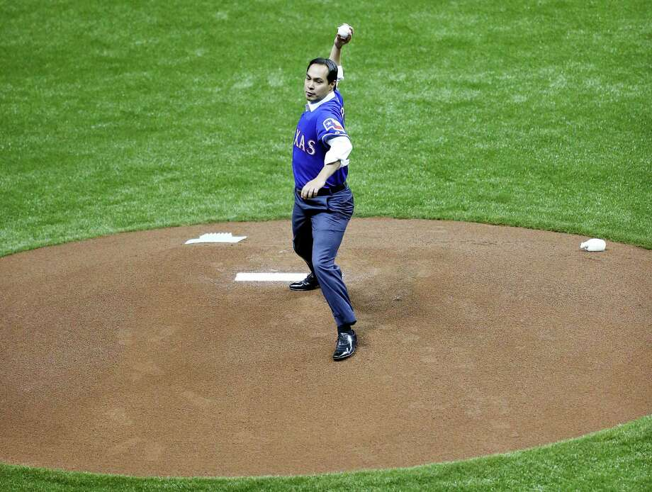 Mayor Julian Castro throws out the first pitch before the Texas Rangers and San Diego Padres exhibition baseball game part of the ÒBig League WeekendÓ Friday March 29, 2013 at the Alamodome. Photo: Edward A. Ornelas, San Antonio Express-News / © 2013 San Antonio Express-News