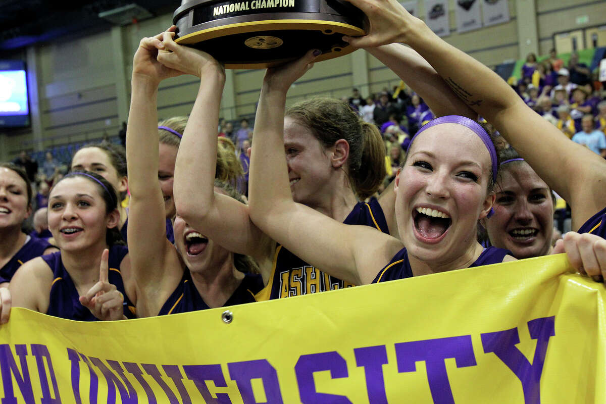 Teammates, including Lindsay Tenyak (right) celebrate as the Ashland Eagles beat the Dowling Golden Lions for the women's division II championship at Greehey Arena on March 29, 2013.
