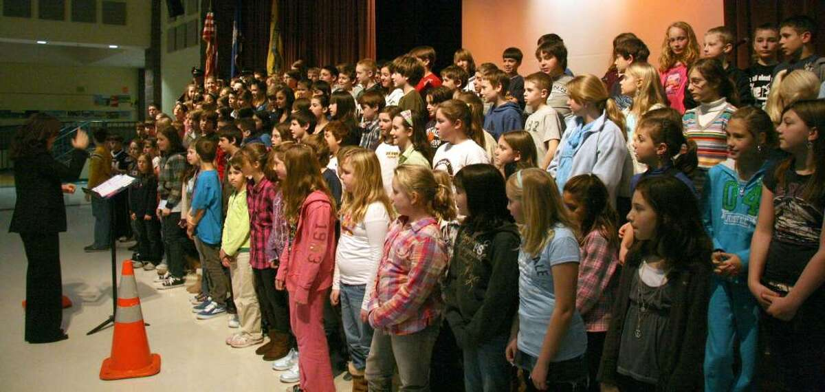 Mrs Michelle Tenenbaum, Reed Chorus Mistress, left with the 5th and 6th Grade Chorus from Reed Intermediate School in Newtown. They sang the Star Spangle Banner, Goober Peas, When the Saints Go Marching In, Over There by George M Cohen. The assembly was held Monday as a kick-off for a Valentine's Day letter writing project for the troops over seas. Mrs Michelle Tenenbaum, Reed Chorus Mistress with the 5th and 6th Grade Chorus They sang the Star Spangle Banner, Goober Peas, When the Saints Go Marching In, and my personal favorite Over There by George M Cohen