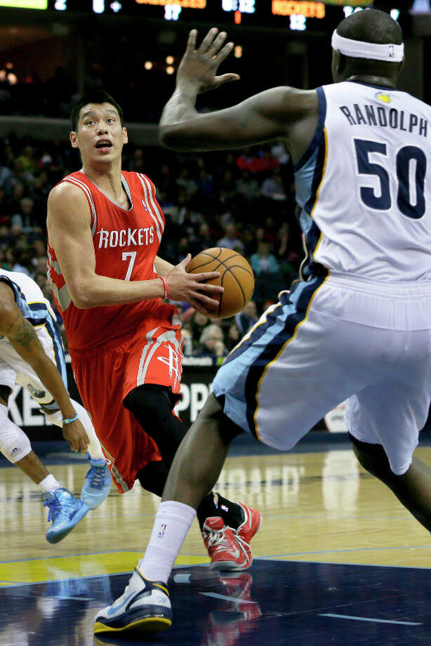 Jeremy Lin of the Rockets works the ball past Zach Randolph of the Grizzlies. Photo: Danny Johnston