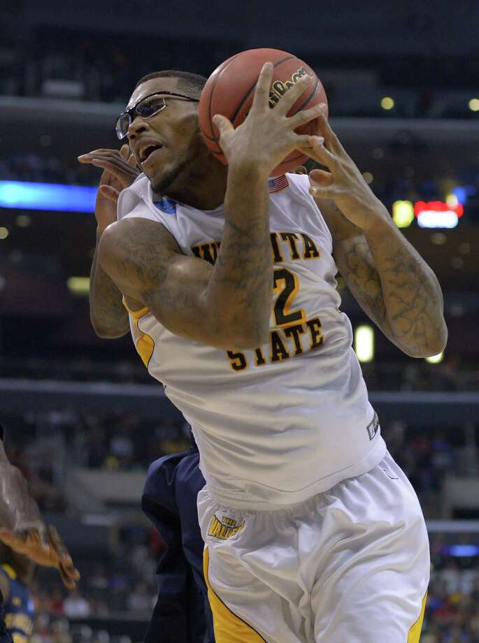 Wichita State forward Carl Hall pulls down a rebound during the first half of a West Regional semifinal against La Salle in the NCAA college basketball tournament, Thursday, March 28, 2013, in Los Angeles. (AP Photo/Mark J. Terrill) Photo: Mark J. Terrill, Associated Press / AP