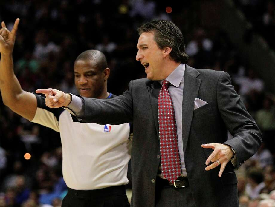 Clippers coach Vinny Del Negro argues with a game official in the game against the Spurs at the AT&T Center on Friday, Mar. 29, 2013. The Spurs defeated the Clippers, 104-102. Photo: Kin Man Hui, San Antonio Express-News / © 2012 San Antonio Express-News
