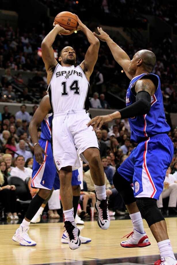 The Spurs' Gary Neal (14) fades back for a jumper over Los Angeles Clippers' Caron Butler (5) in the second half at the AT&T Center on Friday, Mar. 29, 2013. The Spurs defeated the Clippers, 104-102. Photo: Kin Man Hui, San Antonio Express-News / © 2012 San Antonio Express-News