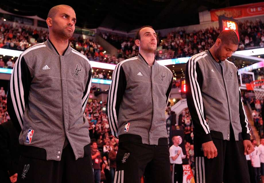 The Spurs' Tony Parker (9), Manu Ginobili (20) and Tim Duncan (21) stand before the National Anthem before the game against the Los Angeles Clippers at the AT&T Center on Friday, Mar. 29, 2013. Photo: Kin Man Hui, San Antonio Express-News / © 2012 San Antonio Express-News