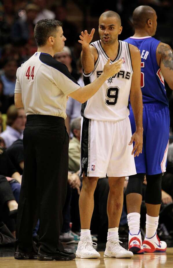 The Spurs' Tony Parker (09) debates a call with a game official in the second half at the AT&T Center on Friday, Mar. 29, 2013. The Spurs defeated the Clippers, 104-102. Photo: Kin Man Hui, San Antonio Express-News / © 2012 San Antonio Express-News