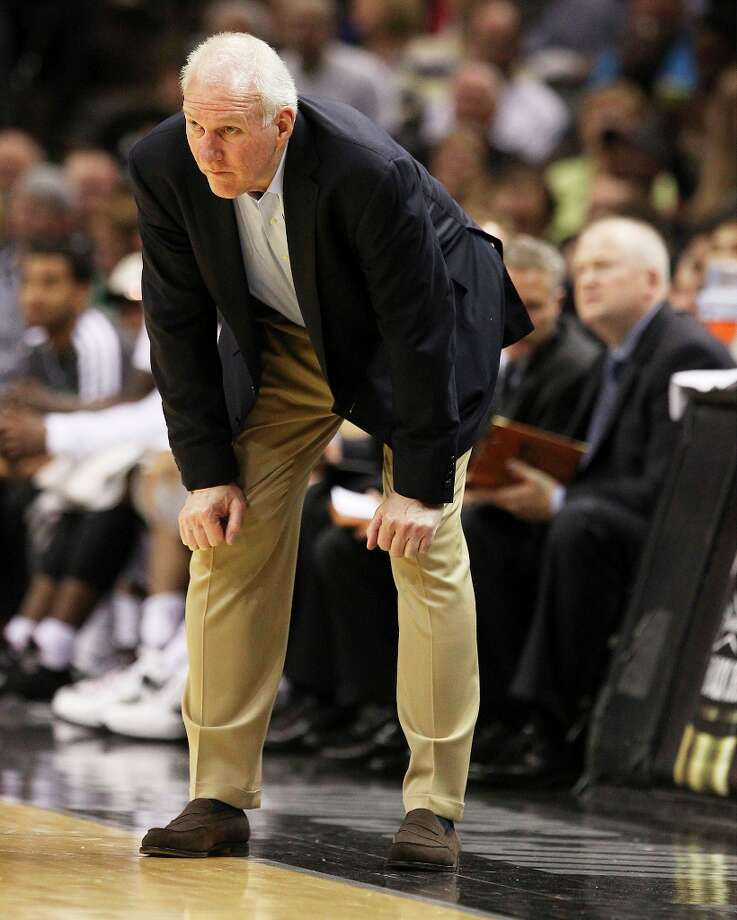 Spurs coach Gregg Popovich hard a tough time watching parts of the game in the second half against the Los Angeles Clippers at the AT&T Center on Friday, Mar. 29, 2013. The Spurs defeated the Clippers, 104-102. Photo: Kin Man Hui, San Antonio Express-News / © 2012 San Antonio Express-News