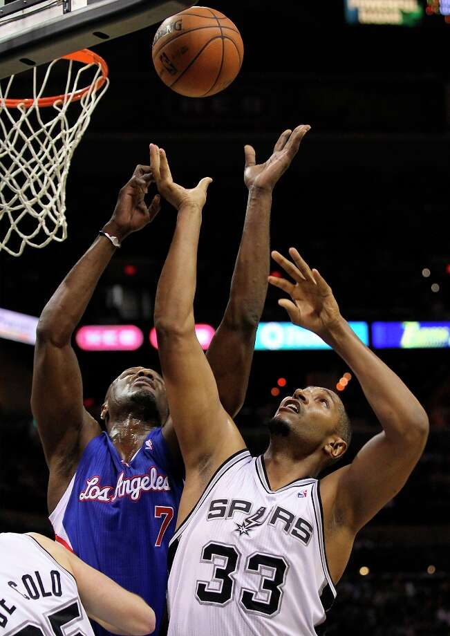 The Spurs' Boris Diaw (33) and Clippers' Lamar Odom (7) go up for rebound in the second half at the AT&T Center on Friday, Mar. 29, 2013. The Spurs defeated the Clippers, 104-102. Photo: Kin Man Hui, San Antonio Express-News / © 2012 San Antonio Express-News