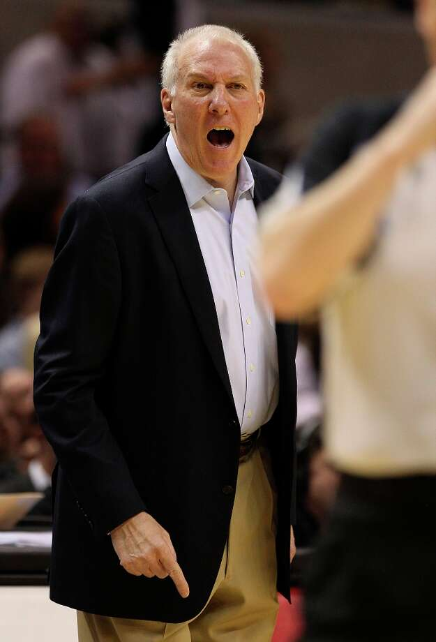 Spurs coach Gregg Popovich screams at an official during the game against the Los Angeles Clippers in the second quarter at the AT&T Center on Friday, Mar. 29, 2013. Photo: Kin Man Hui, San Antonio Express-News / © 2012 San Antonio Express-News