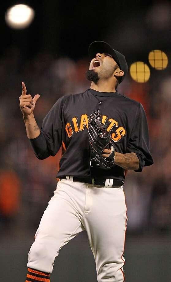 San Francisco Giants' pitcher Sergio Romo celebrates the Giants win over the Oakland Athletics in their exhibition spring training baseball game Friday, March 29, 2013 in San Francisco Calif. Photo: Lance Iversen, The Chronicle