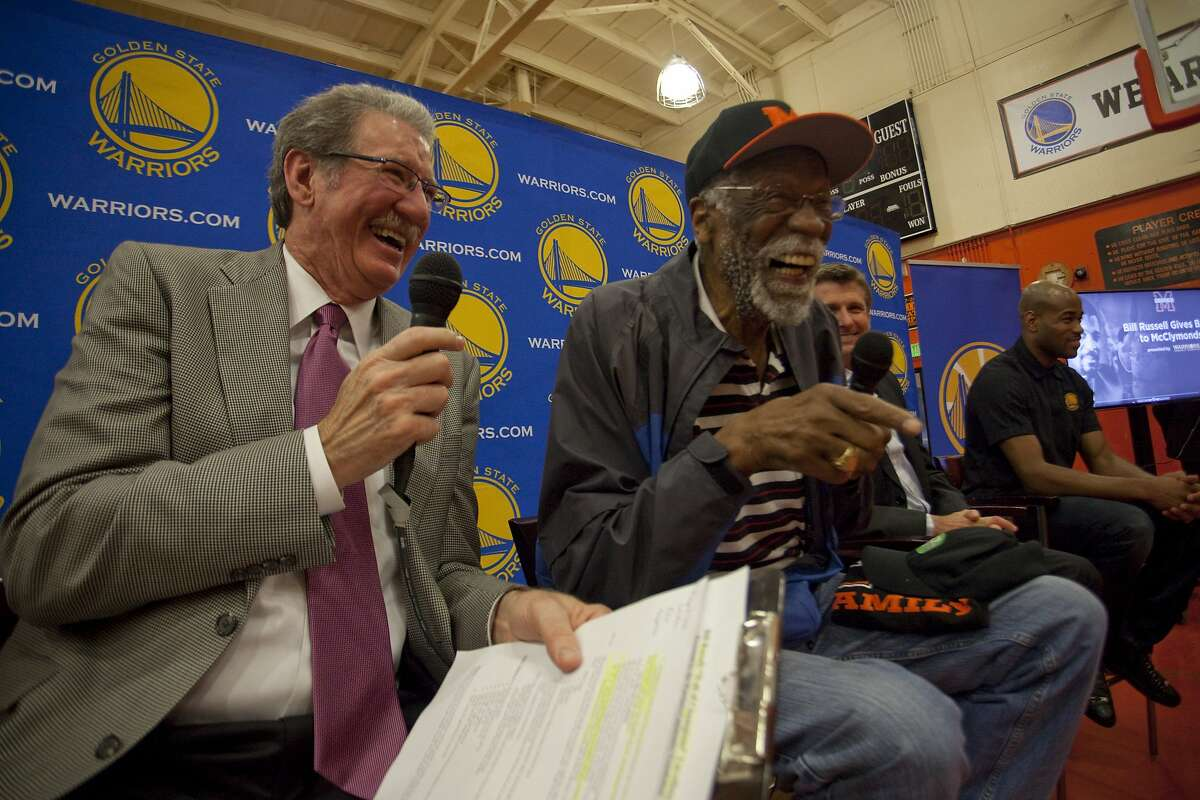Jim Barnett (left), and Bill Russell during the unveiling event for the Bill Russell Wall of Champions at McClymonds high school in Oakland California on March 26th 2013. The event also included the unveiling of a newly renovated team room, weight room and aerobics room, in addition to a short practice led by current Warriors players Jarrett Jack and Harrison Barnes.