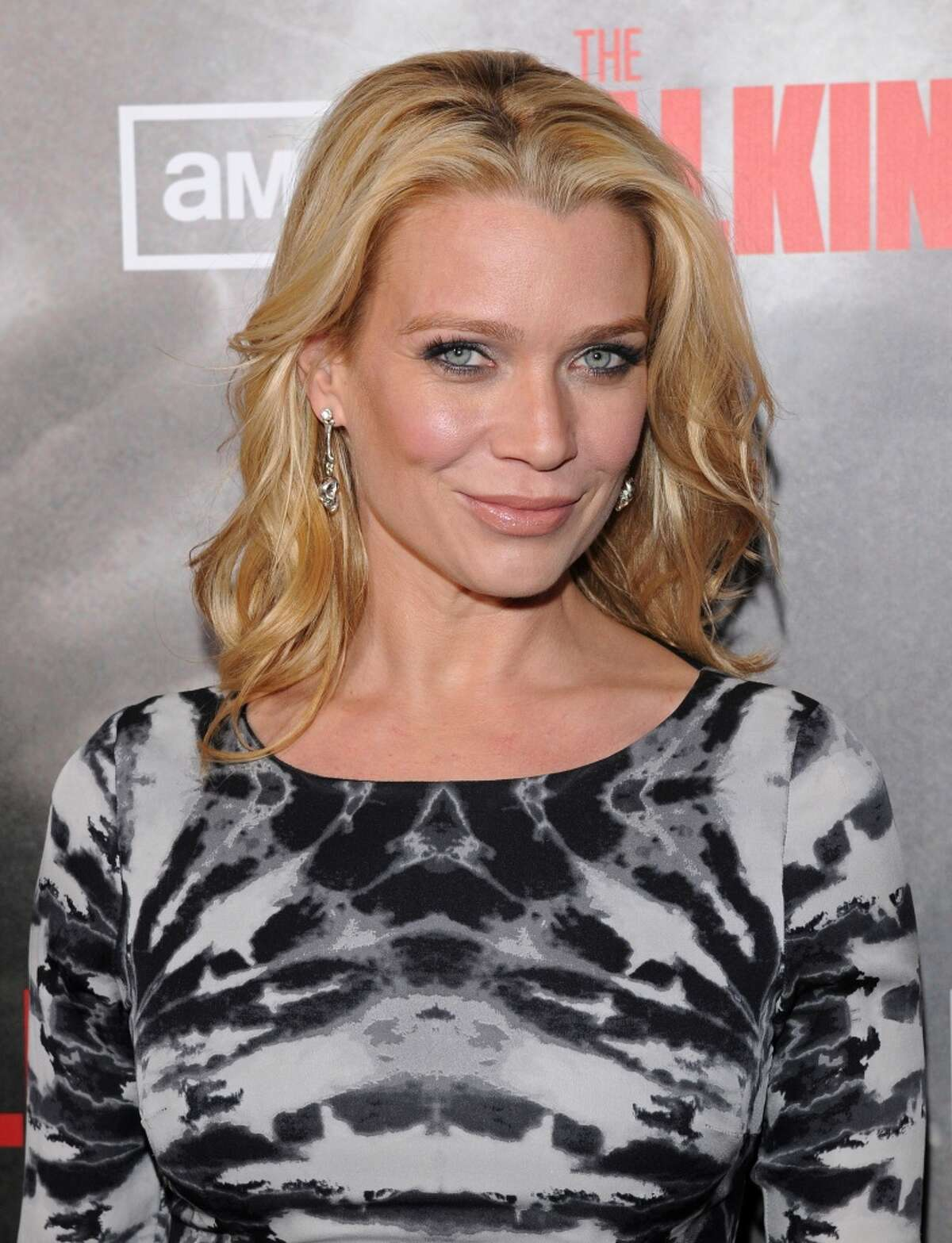 Laurie Holden , who played the zombie-fighter who almost became a zombie herself on 'The Walking Dead', is a hero in real life as well. Holden reportedly was involved in an undercover operation that helped free 55 sex slaves in Cambodia.Keep clicking to see other celebrities -- living and dead -- and their causes.