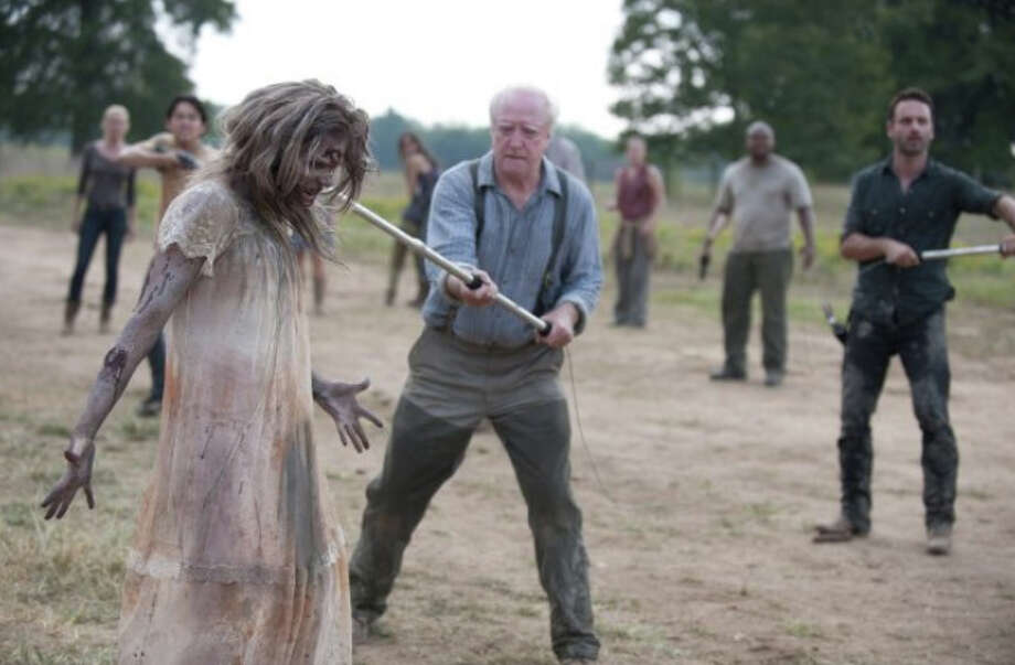 Hershel, on ''The Walking Dead.'' (He's pictured wrangling a zombie).
