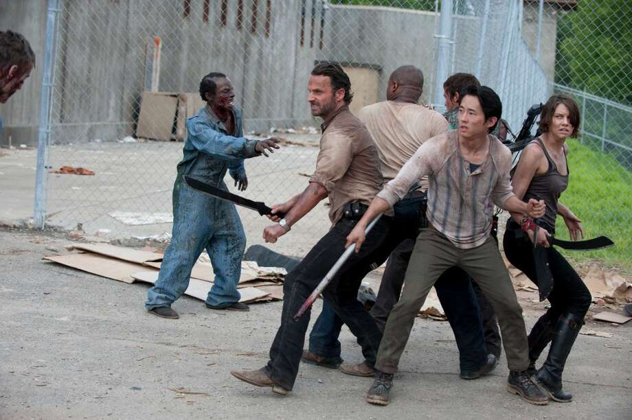Fighting off the zombies galore: (L-R) Rick Grimes (Andrew Lincoln), T-Dog (Robert 'IronE' Singleton), Daryl Dixon (Norman Reedus), Glenn (Steven Yeun) and Maggie Greene (Lauren Cohan).
