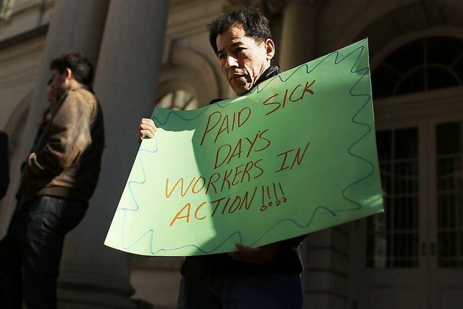 NEW YORK, NY - MARCH 29:  A man holds a sign at a rally in front of City Hall to show support for a paid sick leave bill, a day after New York City Council Speaker Christine Quinn announced that lawmakers and advocates reached a deal on the legislation March 29, 2013 in New York City. The bill would force businesses with 20 or more employees to provide five paid sick days a year beginning in April 2014. New York Mayor Michael Bloomberg, who opposes the bill, said he would veto it if it comes to his desk.  (Photo by Spencer Platt/Getty Images) Photo: Spencer Platt, Getty Images