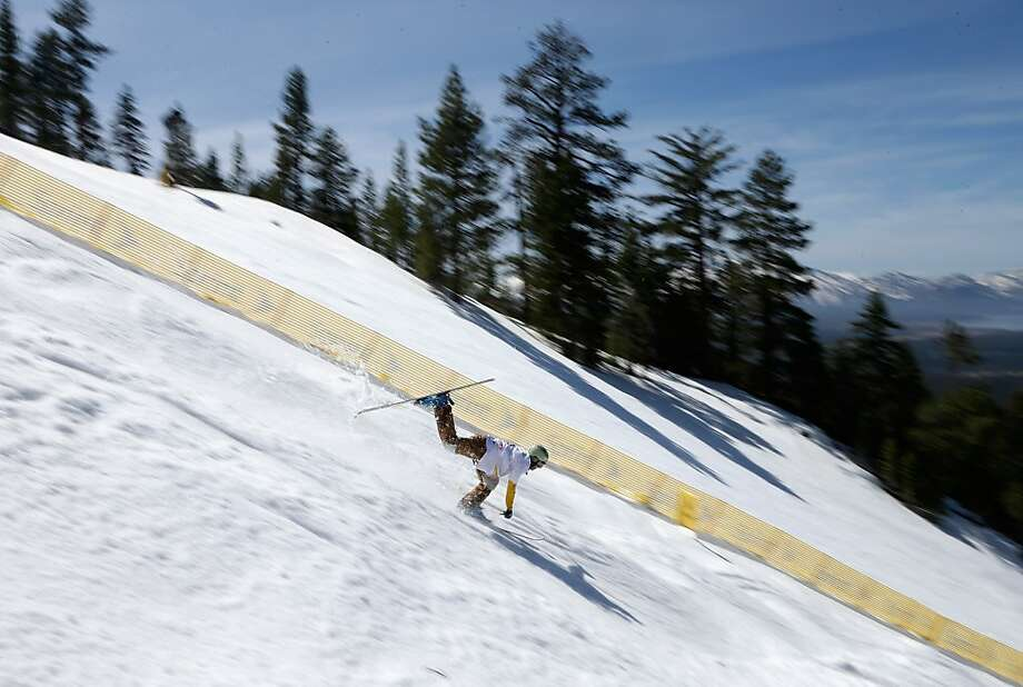 SOUTH LAKE TAHOE, CA - MARCH 29:  Trevor Semmens loses his balance during a training run in the Men's Moguls at the U.S. Freestyle Moguls National Championship at Heavenly Resort on March 29, 2013 in South Lake Tahoe, California.  (Photo by Ezra Shaw/Getty Images) Photo: Ezra Shaw, Getty Images