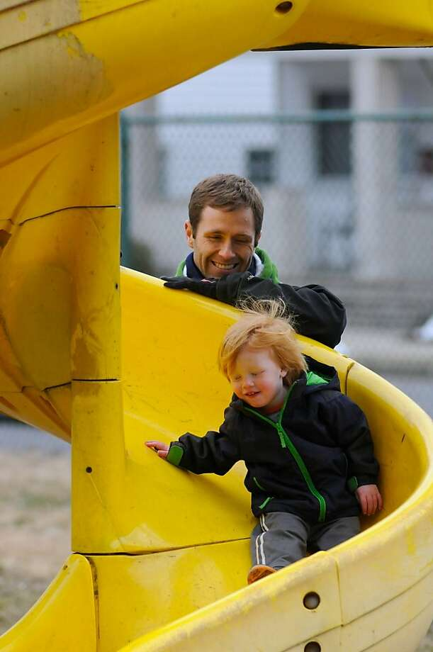 Christian Halupa,  watches his son Grant slide down the slide at Frackville Memorial Park Friday afternoon, March 29, 2013 in Frackville, Pa.(AP Photo/Republican-Herald, Jacqueline Dormer) Photo: Jacqueline Dormer, Associated Press