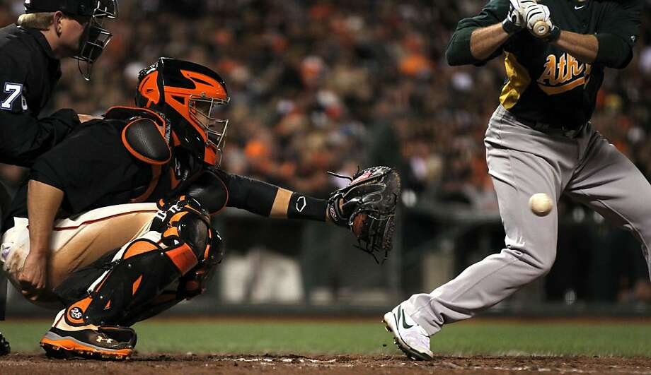 San Francisco Giants' catcher Buster Posey works the 7th inning behind the plate as Oakland Athletics Scott Sizemore bats during their exhibition spring training baseball game Friday, March 29, 2013 in San Francisco Calif. Photo: Lance Iversen, The Chronicle