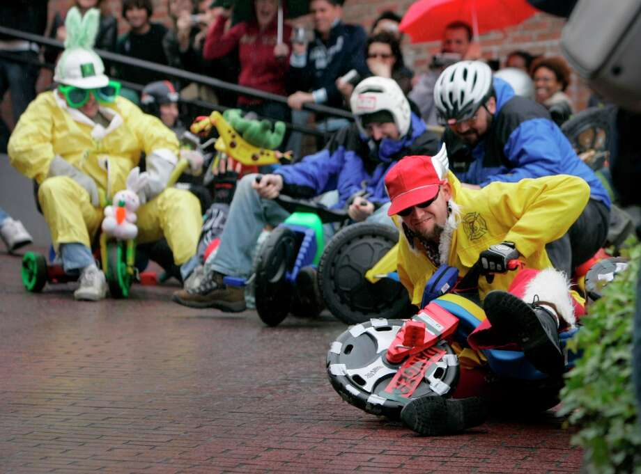 Cody Barkley of San Francisco takes the lead in the Bring Your Own Big Wheel race down Lombard Street on April 16, 2006, in San Francisco. The race started on Lombard Street before moving to Potrero Hill in recent years. Photo: Lacy Atkins, Sfc / chronicle