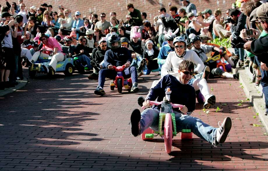 Racers head down Lombard Street during the Bring Your Own Big Wheel event on April 8, 2007, in San Francisco. 2007 was the last year it was held on Lombard Street. Photo: Lacy Atkins, Sfc / chronicle