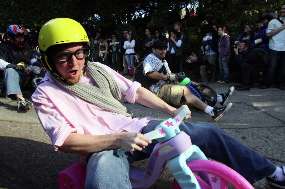 Participants in the eighth annual Bring Your Own Big Wheel Race make their way down Vermont Street in the Potrero Hill neighborhood of San Francisco on March 23, 2008. Photo: Laura Morton, SFC / Chronicle
