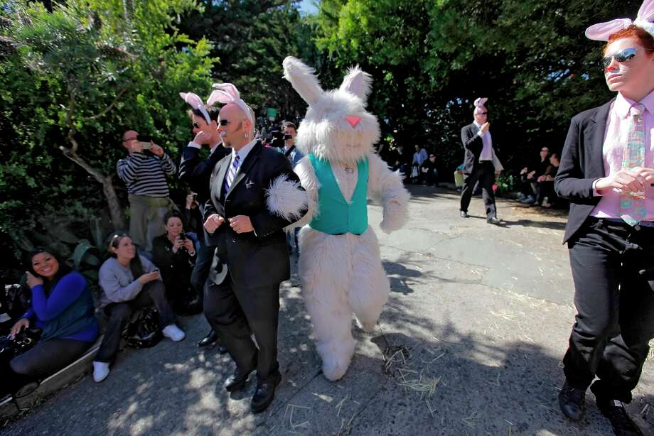 An Easter Bunny is escorted by secret service agents on Vermont Street during the Bring Your Own Big Wheel race April 24, 2011, in San Francisco. Photo: Lacy Atkins, The Chronicle / SFC