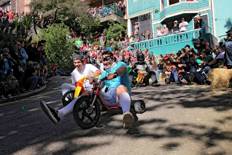 Racers speed down Vermont Street in the 11th annual Bring Your Own Big Wheel race on April 24, 2011, in San Francisco. Photo: Lacy Atkins, The Chronicle / SFC