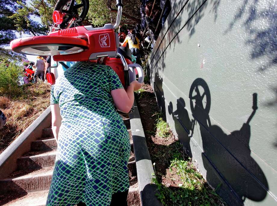Participants walk up Vermont Street in the 11th annual Bring Your Own Big Wheel race on April 24, 2011, in San Francisco. Photo: Lacy Atkins, The Chronicle / SFC