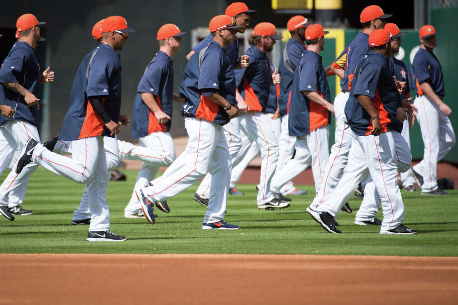 Astros players warm up before an exhibition against the Cubs. Photo: Smiley N. Pool, Houston Chronicle / © 2013  Smiley N. Pool