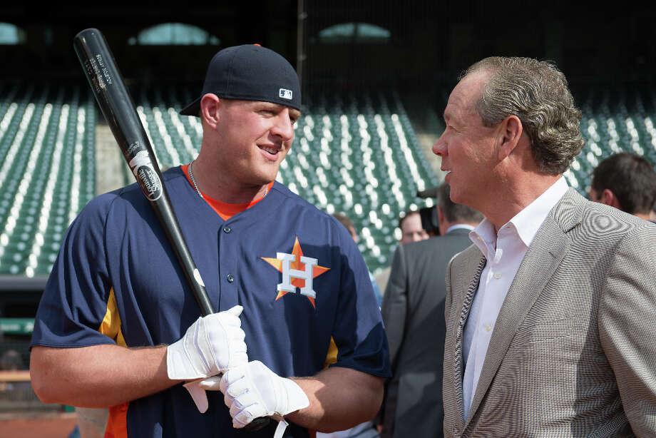 Texans defensive end J.J. Watt speaks with Astros owner Jim Crane before taking batting practice. Photo: Smiley N. Pool, Houston Chronicle / © 2013  Smiley N. Pool