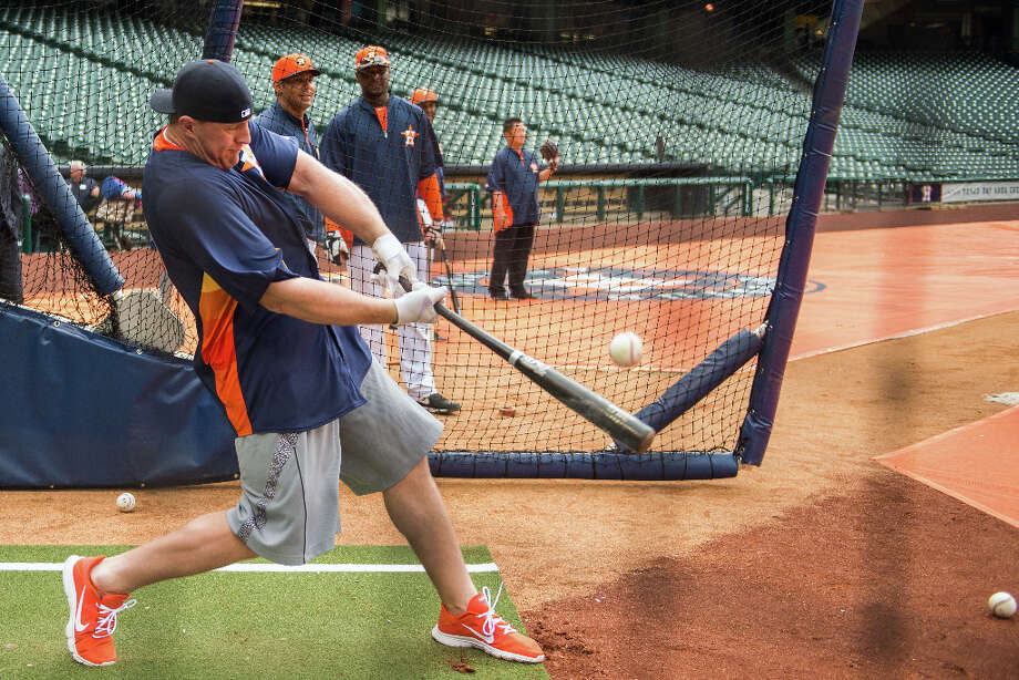 Texans defensive end J.J. Watt connects on a pitch as he takes batting practice with the Astros. Watt hit five home runs. Photo: Smiley N. Pool, Houston Chronicle / © 2013  Smiley N. Pool