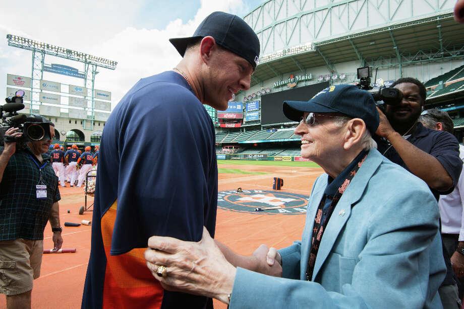 Texans defensive end J.J. Watt greets Milo Hamilton before batting practice. Photo: Smiley N. Pool, Houston Chronicle / © 2013  Smiley N. Pool