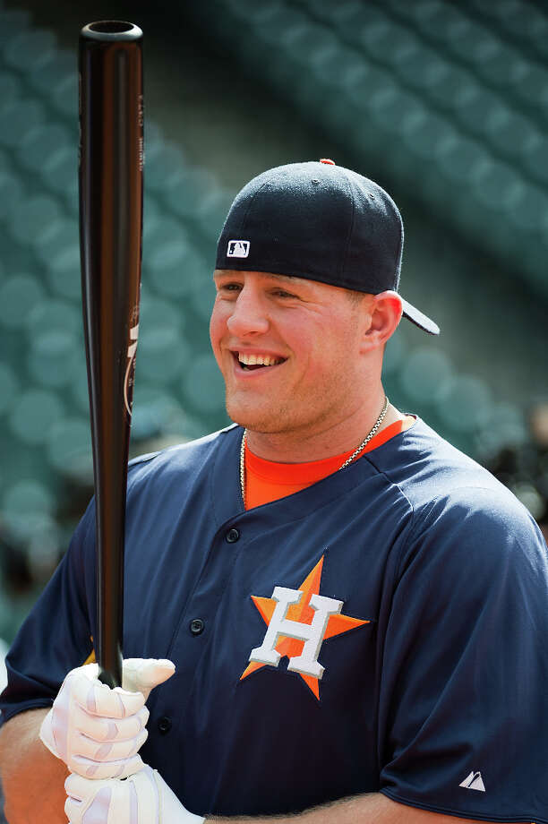 Texans defensive end J.J. Watt warms up during batting practice with the Astros. Photo: Smiley N. Pool, Houston Chronicle / © 2013  Smiley N. Pool