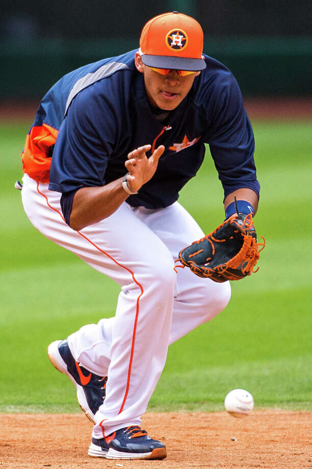 Carlos Correa fields a grounder during warmups. Photo: Smiley N. Pool, Houston Chronicle / © 2013  Smiley N. Pool