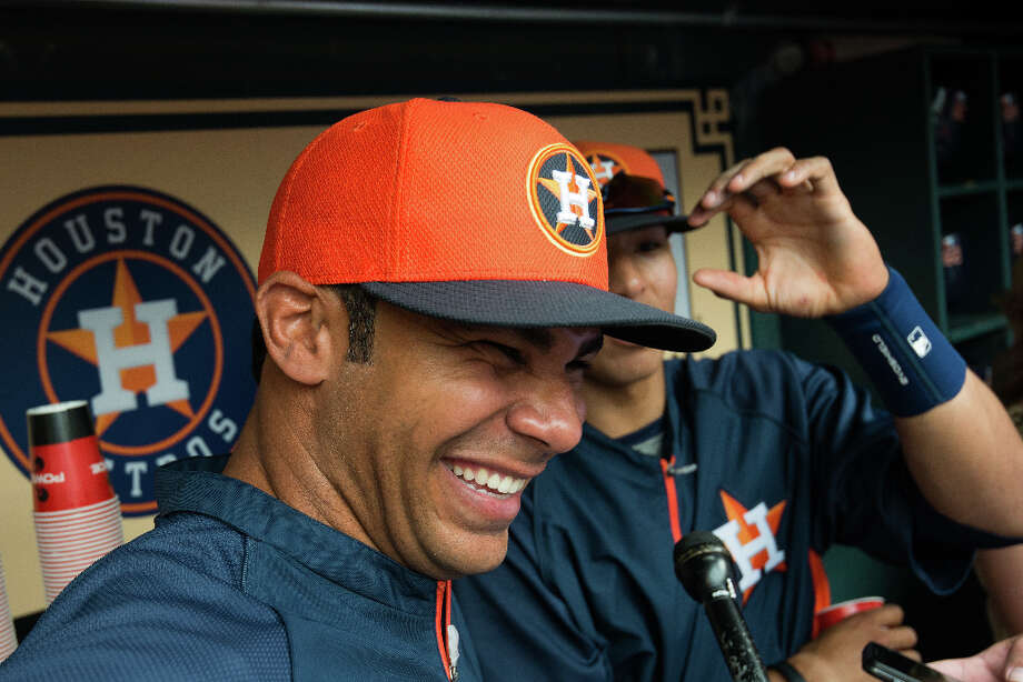 Astros teammates Carlos Pena and Carlos Correa share a laugh in the dugout. Photo: Smiley N. Pool, Houston Chronicle / © 2013  Smiley N. Pool