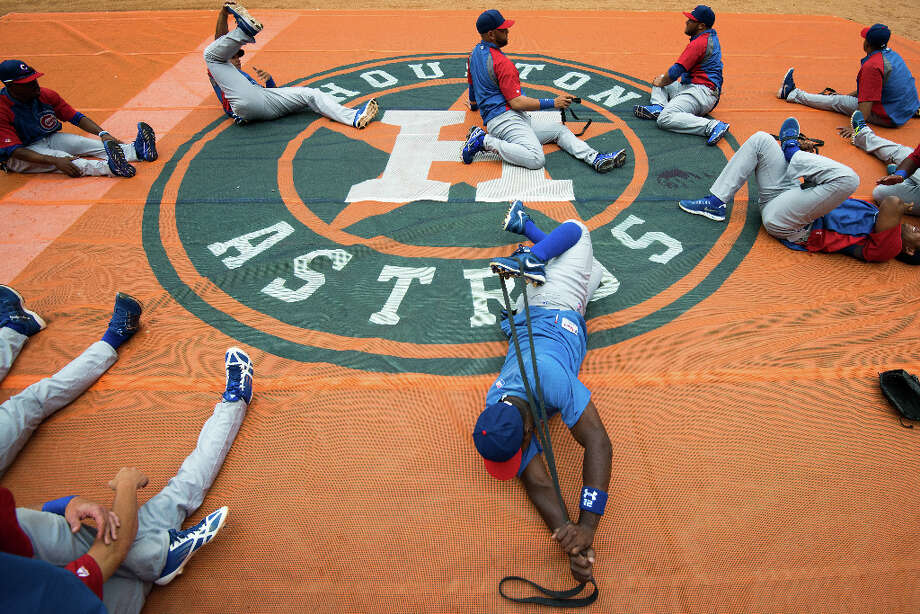 Cubs players stretch before facing the Astros. Photo: Smiley N. Pool, Houston Chronicle / © 2013  Smiley N. Pool