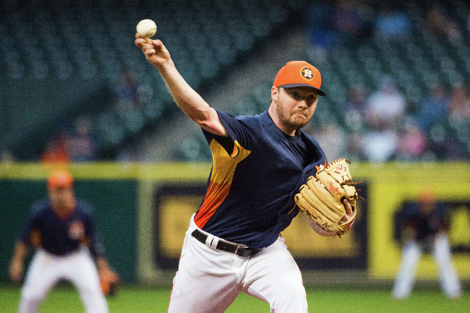 Astros pitcher Alex White delivers a pitch during the first inning against the Cubs.  White exited the game with elbow discomfort after one inning. HeÕll be examined by team doctors Saturday morning. Photo: Smiley N. Pool, Houston Chronicle / © 2013  Smiley N. Pool