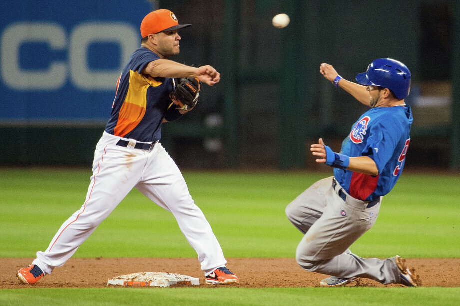 Astros second baseman Jose Altuve makes the relay over Cubs outfielder David DeJesus to complete a double play during the second inning. Photo: Smiley N. Pool, Houston Chronicle / © 2013  Smiley N. Pool