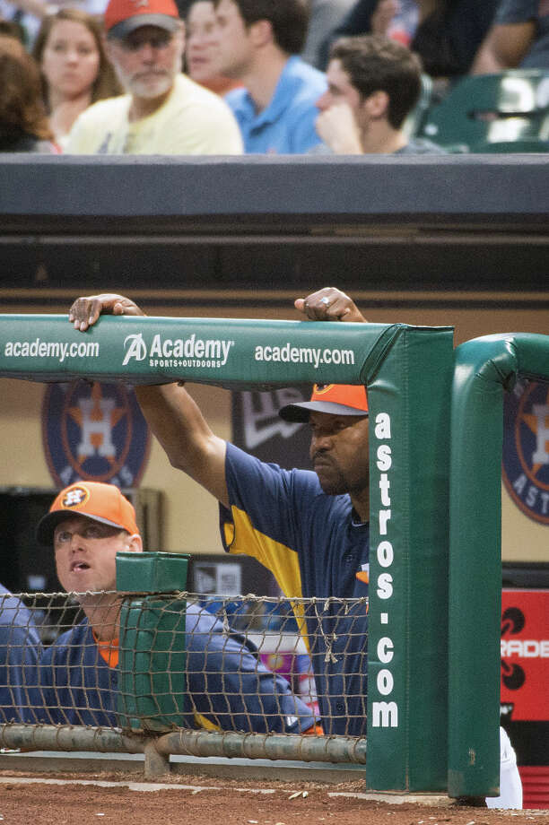Astros manager Bo Porter watches his team from the dugout against the Cubs. Photo: Smiley N. Pool, Houston Chronicle / © 2013  Smiley N. Pool