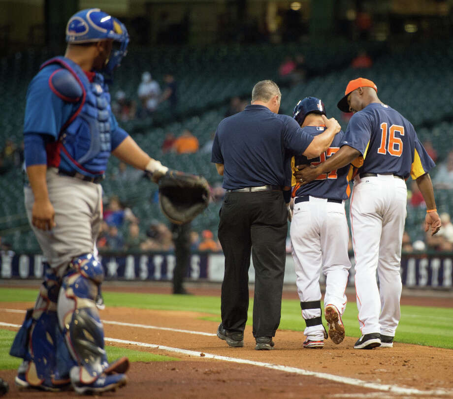 Astros manager Bo Porter checks on second baseman Jose Altuve after he was hit by a pitch. Photo: Smiley N. Pool, Houston Chronicle / © 2013  Smiley N. Pool
