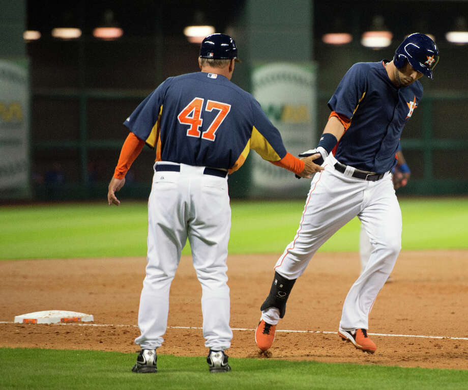 Marwin Gonzales of the Astros is congratulated by third base coach Dave Trembley after he hit a home run. Photo: Smiley N. Pool, Houston Chronicle / © 2013  Smiley N. Pool